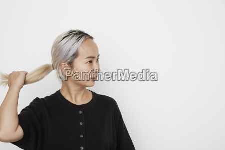 woman holding her pony tail