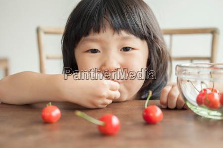 girl eating cherries portrait