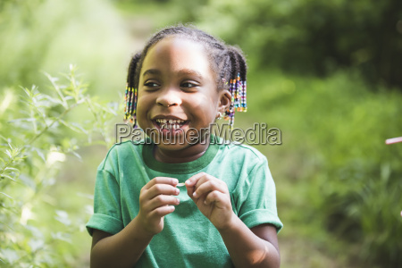 portrait of girl with plant in
