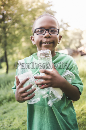 portrait of boy holding with plastic