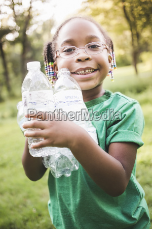portrait of girl holding with plastic