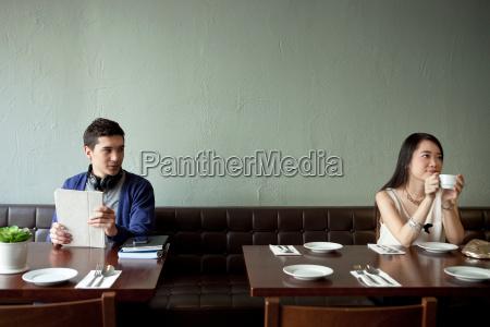 young man looking at young woman