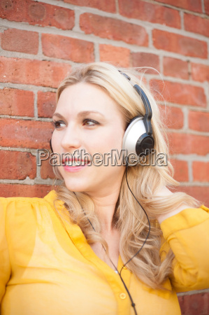 close up of woman with headphones