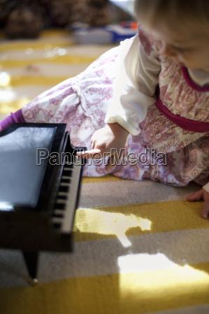 female toddler sitting on living room