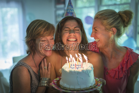 mature woman holding birthday cake making