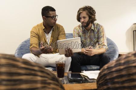 two men having meeting in coffee