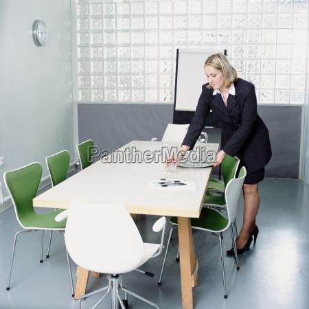 secretary preparing the meeting room
