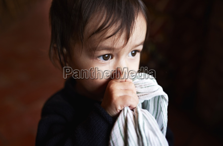 portrait of male toddler holding up