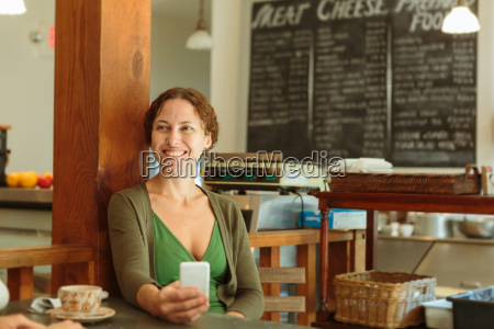 mid adult woman with smartphone in