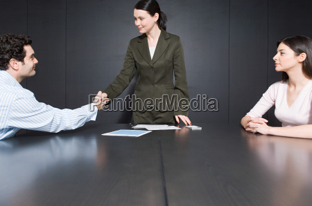 man shaking hands with divorce lawyer