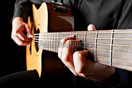 close up of person playing classical