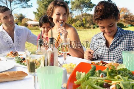 family eating meal in garden