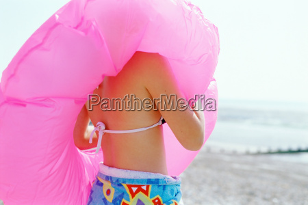 girl on the beach with inflatable