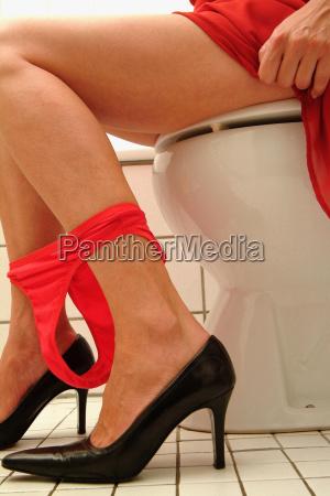 woman on toilet seat