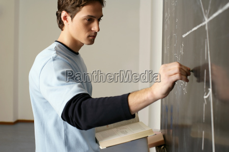 student working on maths problem