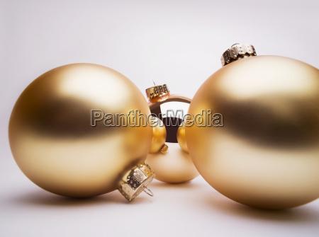 gold christmas decorations studio shot