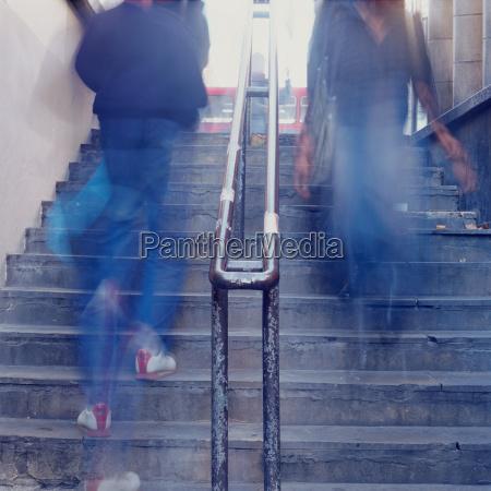 blurred people on stairway