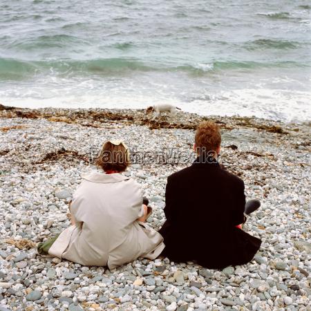 sitting down on a pebble beach