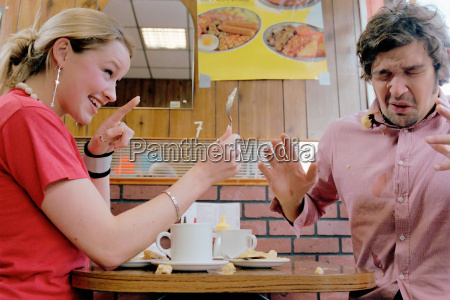 couple playing in cafe