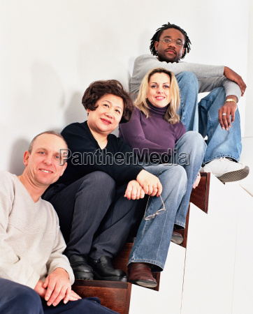 multiracial people on stairs