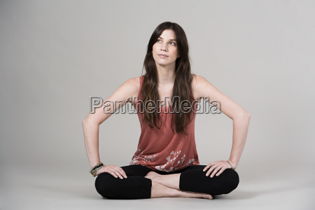 woman sitting cross legged