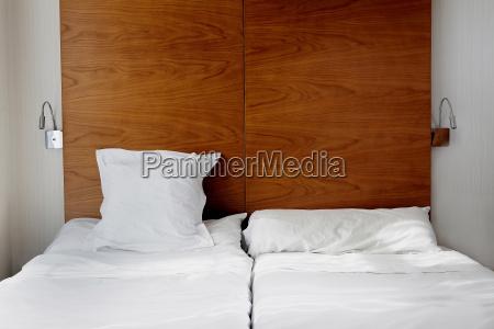 empty bed with white bed linen