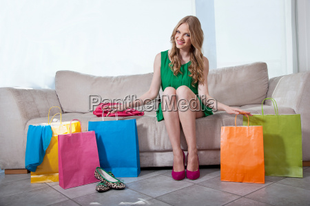 young woman sitting on sofa with