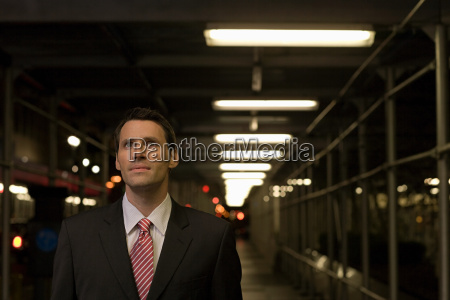 stunned looking businessman in a walkway