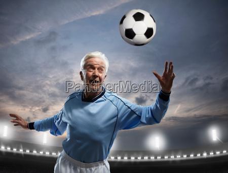 senior man playing football