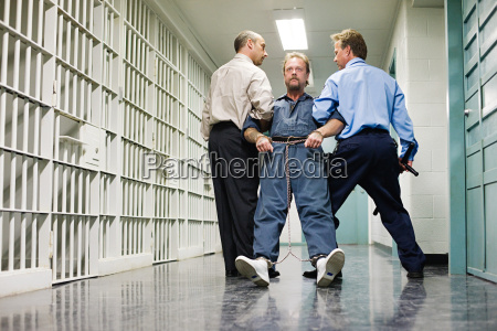 prisoner being dragged down corridor