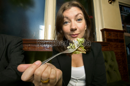 a businesswoman having a salad in