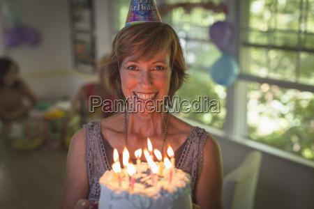 portrait of mature woman holding birthday