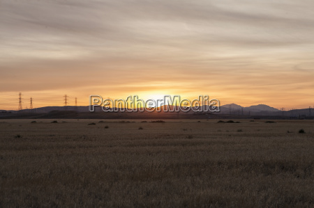 sunset over distant mountains los banos