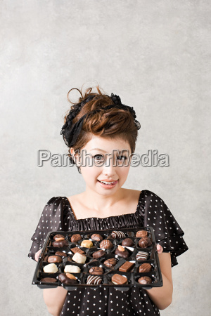 woman with tray of chocolates