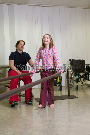 girl walking using support bars