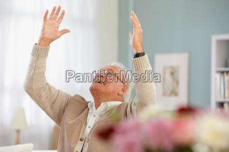 senior man cheering