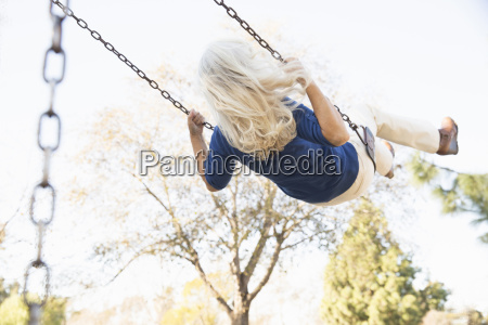 senior woman playing swing hahn park