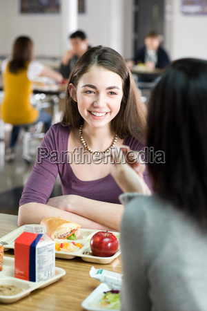 female school students having lunch