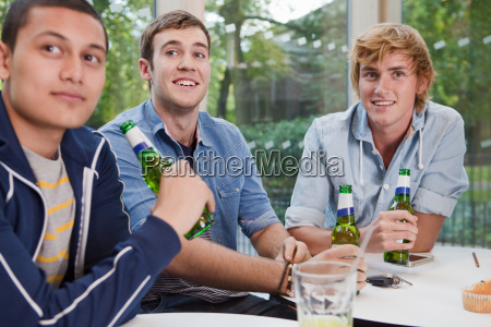 university students enjoying a beer in