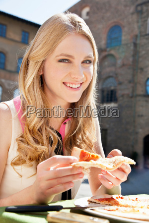 young woman at restaurant outdoors with