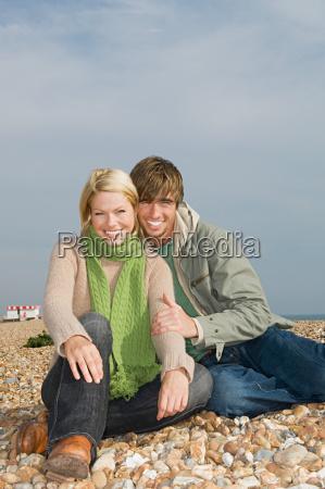 couple sitting on beach