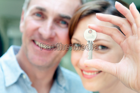 woman holding house key man in