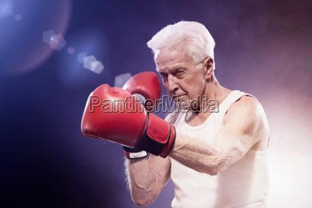 senior man boxing