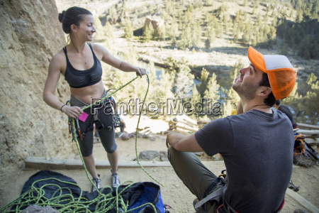 rock climber preparing rope smith rock