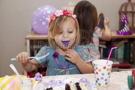 portrait of girl sitting at birthday