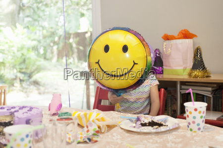 girl sitting at birthday party table