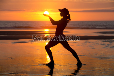 silhouette of young woman by the