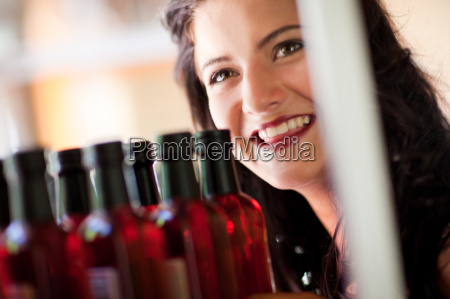 smiling woman shopping for vinegar