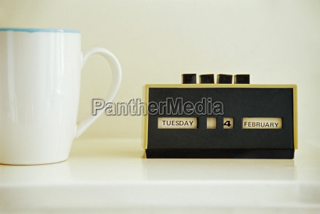 coffee cup and retro calendar