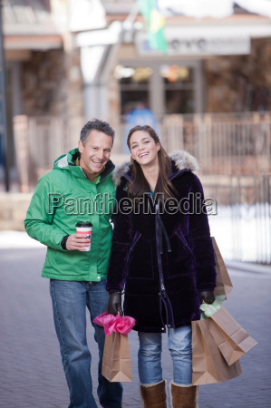 young woman carrying shopping bags with